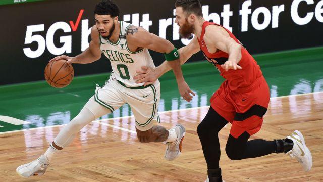Boston Celtics forward Jayson Tatum and Toronto Raptors center Aron Baynes