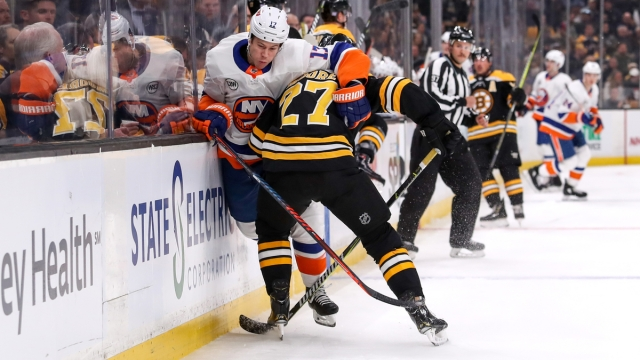 Boston Bruins defenseman John Moore, New York Islanders forward Matt Martin