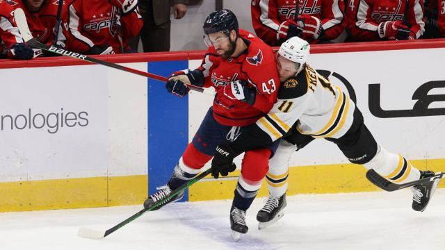Washington Capitals right wing Tom Wilson and Boston Bruins center Trent Frederic
