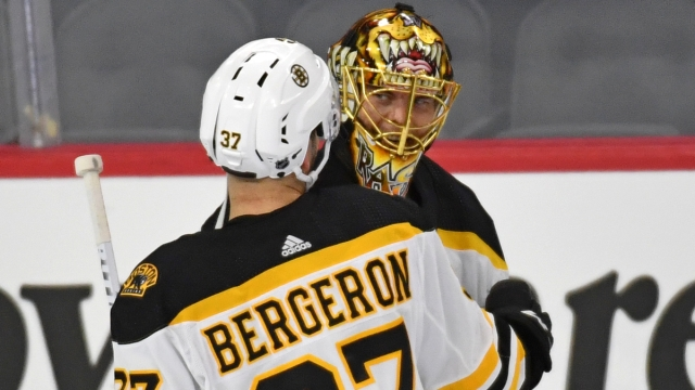 Boston Bruins center Patrice Bergeron, goaltender Tuukka Rask