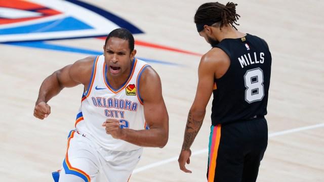 Oklahoma City Thunder center Al Horford (42) and San Antonio Spurs guard Patty Mills (8)
