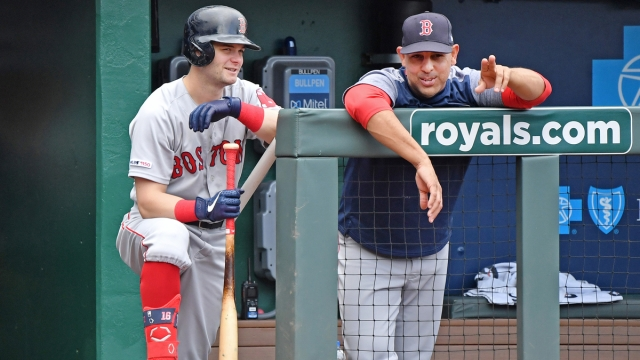 Kansas City Royals Outfielder Andrew Benintendi And Boston Red Sox Manager Alex Cora
