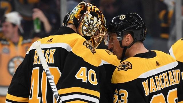 Boston Bruins goalie Tuukka Rask, winger Brad Marchand