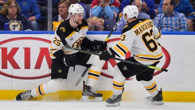 Boston Bruins defenseman Brandon Carlo, winger Brad Marchand