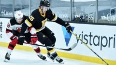 Boston Bruins defenseman Brandon Carlo, New Jersey Devils forward Jesper Bratt