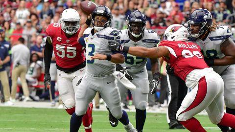 Arizona Cardinals linebacker Chandler Jones and Seattle Seahawks quarterback Russell Wilson