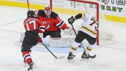New Jersey Devils goaltender Mackenzie Blackwood (29) and Boston Bruins defenseman Charlie McAvoy (73)