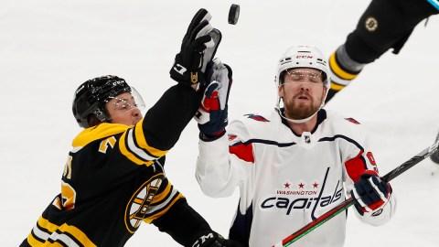 Boston Bruins defenseman Charlie McAvoy, Washington Capitals defenseman Dmitry Orlov