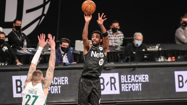 Boston Celtics forward Daniel Theis and Brooklyn Nets guard Kyrie Irving