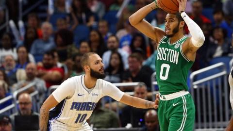 Boston Celtics forwards Evan Fournier (left) and Jayson Tatum (right)