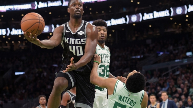 Sacramento Kings forward Harrison Barnes (40) and Boston Celtics guards Tremont Waters (5) and Marcus Smart (36)