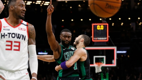 Boston Celtics forwards Jaylen Brown (7) reacts with forward Jayson Tatum (0)