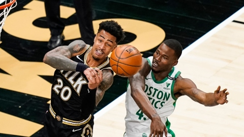 Atlanta Hawks forward John Collins (20) and Boston Celtics guard Javonte Green (43)