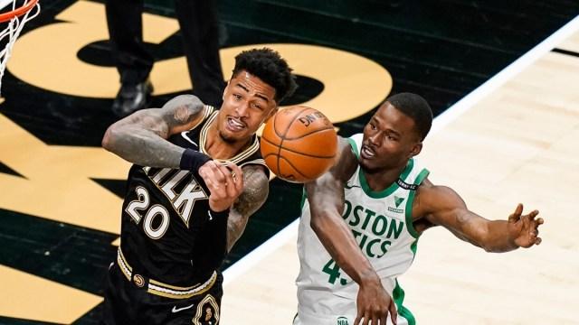 Atlanta Hawks forward John Collins (20) and Boston Celtics guard Javonte Green (43)