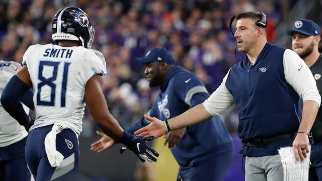 Patriots tight end Jonnu Smith, Titans head coach Mike Vrabel