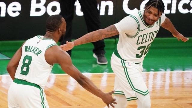 Boston Celtics guards Kemba Walker (8) and Marcus Smart (36)