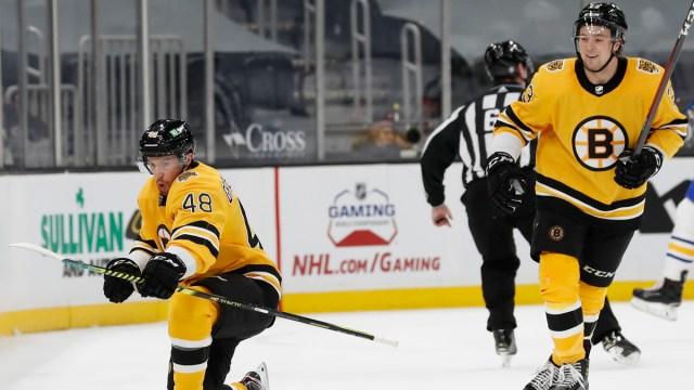 Boston Bruins defensemen Charlie McAvoy, Matt Grzelcyk