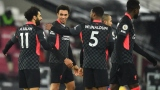 Liverpool forward Mohamed Salah (11), defender Trent Alexander-Arnold (66) and midfielder Georginio Wijnaldum