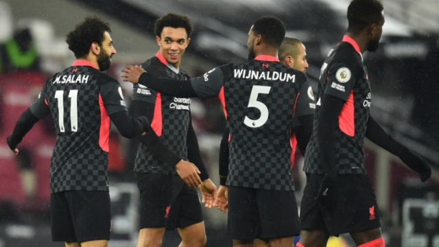 Liverpool forward Mohamed Salah (11), defender Trent Alexander-Arnold (66) and midfielder Georginio Wijnaldum