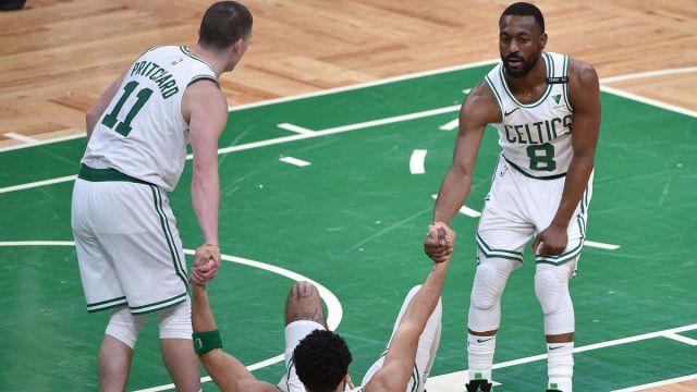 Boston Celtics guards Payton Pritchard and Kemba Walker and forward Jayson Tatum