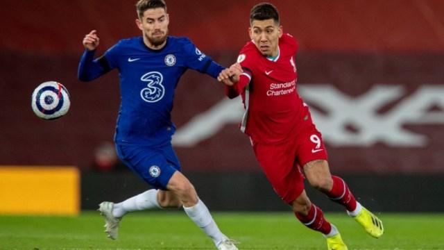 Liverpool forward Roberto Firmino (right)