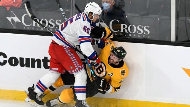 Boston Bruins center David Krejci, New York Rangers defenseman Ryan Lindgren