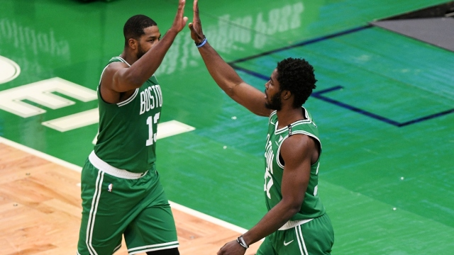 Boston Celtics center Tristan Thompson (13) and forward Semi Ojeleye