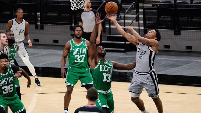 Boston Celtics center Tristan Thompson (13) and San Antonio Spurs forward Keldon Johnson (3)
