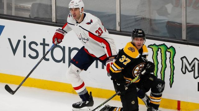 Washington Capitals defenseman Zdeno Chara, Boston Bruins defenseman Patrice Bergeron