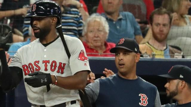 Milwaukee Brewers center fielder Jackie Bradley Jr., Boston Red Sox manager Alex Cora