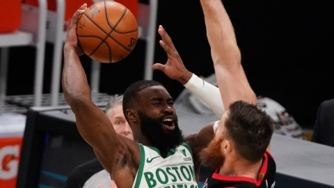 Boston Celtics forward Jaylen Brown, Toronto Raptors center Aron Baynes