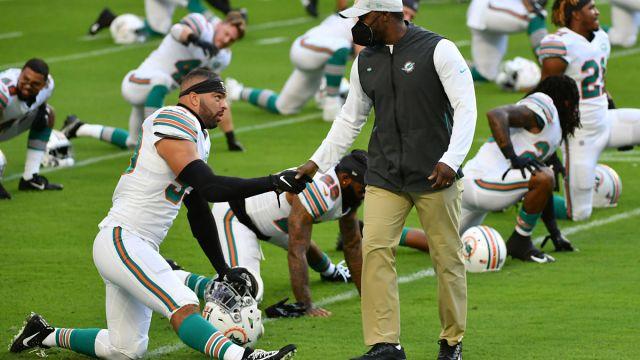 New England Patriots linebacker Kyle Van Noy and Miami Dolphins head coach Brian Flores