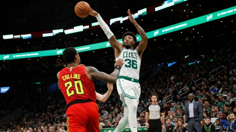Boston Celtics guard Marcus Smart, Atlanta Hawks forward John Collins