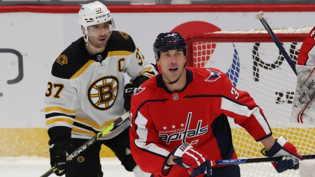 Boston Bruins center Patrice Bergeron, Washington Capitals defenseman Zdeno Chara