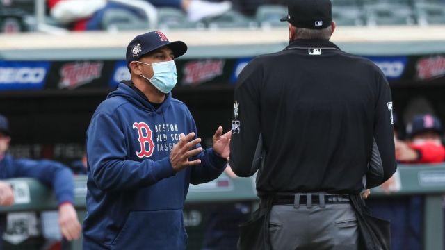 Boston Red Sox manager Alex Cora, MLB Umpire Jordan Baker