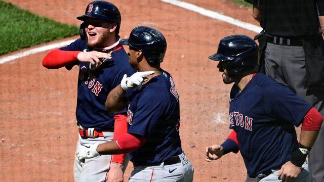 Boston Red Sox outfielder Alex Verdugo, third baseman Rafael Devers and designated hitter J.D. Martinez