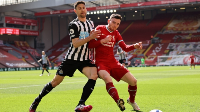 Liverpool defender Andrew Robertson (right) and a Newcastle player