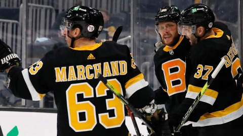 Boston Bruins forwards Brad Marchand, Patrice Bergeron and David Pastrnak