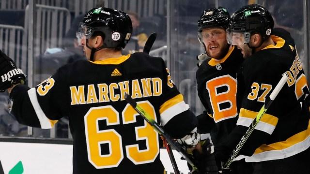 Boston Bruins forwards Brad Marchand, Patrice Bergeron and David Pastrnak
