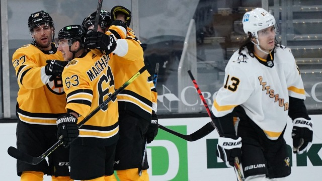Boston Bruins Forwards Brad Marchand, David Pastrnak and Patrice Bergeron