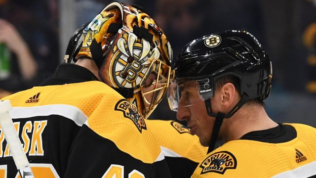 Boston Bruins winger Brad Marchand, goalie Tuukka Rask