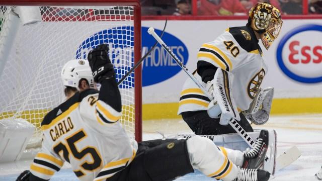 Boston Bruins defenseman Brandon Carlo, goalie Tuukka Rask
