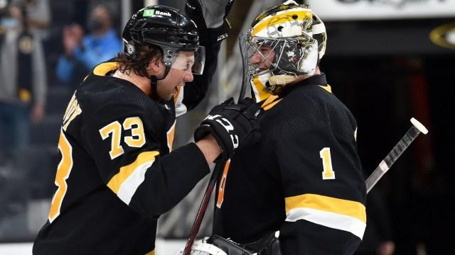 Boston Bruins defenseman Charlie McAvoy (73) and goaltender Jeremy Swayman (1)