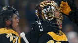 Boston Bruins defenseman Charlie McAvoy, goalie Tuukka Rask