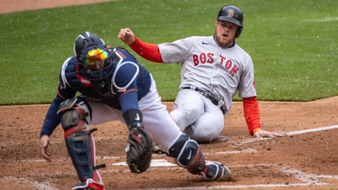 Boston Red Sox second baseman Christian Arroyo (39) and Minnesota Twins catcher Mitch Garver (8)