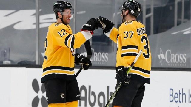 Boston Bruins Forward Craig Smith and Patrice Bergeron