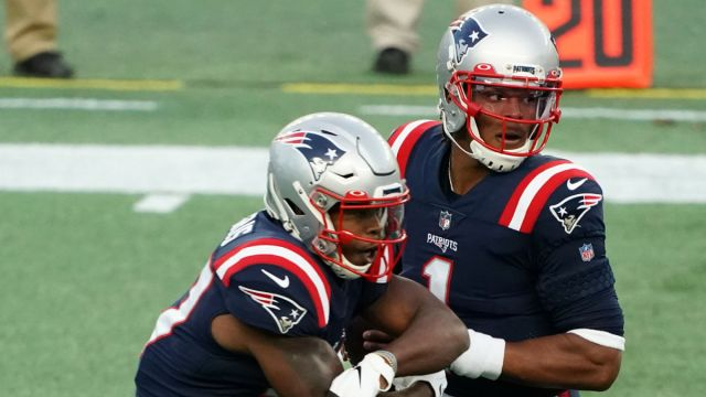 New England Patriots running back Damien Harris and quarterback Cam Newton