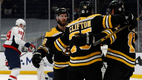 Boston Bruins center David Krejci, winger Craig Smith, defenseman Connor Clifton