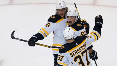 Boston Bruins wingers David Pastrnak and Brad Marchand and center Patrice Bergeron