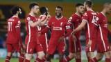 Liverpool forward Diogo Jota (20), midfielder Georginio Wijnaldum (5) and teammates